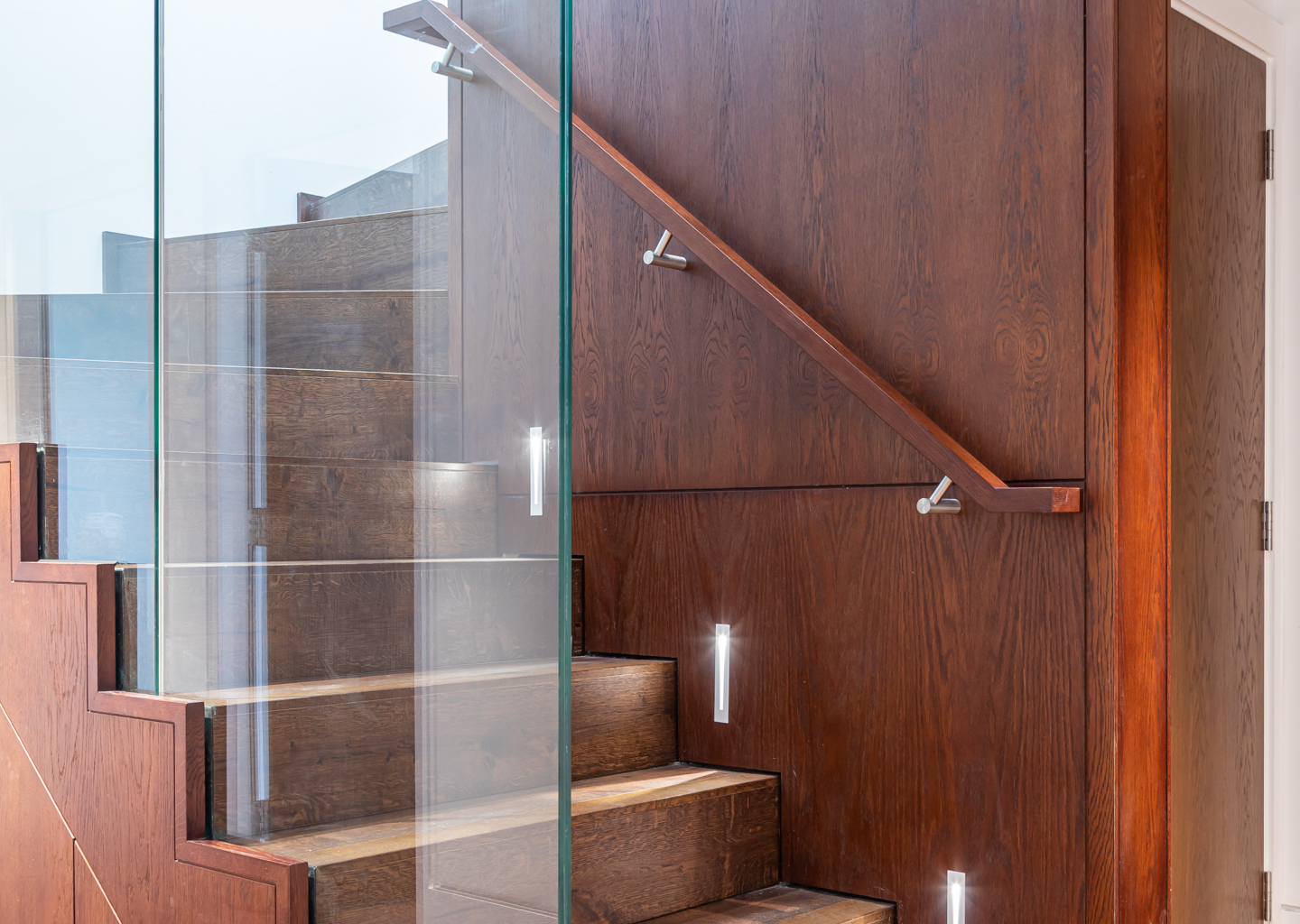 Essoldo House Bespoke Staircase with glass by JSJ UK